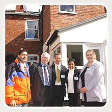 Josh Kaushal, Lord Rooker, and members from Black Country Housing Association